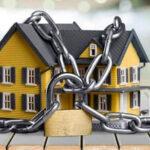 Скасування заочного рішення та зняття арешту з майна